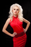 Young, beautiful, blonde woman in red dress. Studio shot of a young, beautiful, blonde woman in red dress stock photo