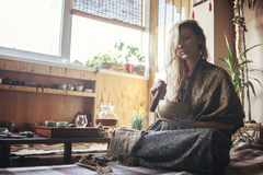 Young beautiful blonde woman. At rest after tea ceremony stock images