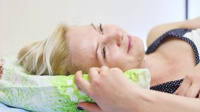Young beautiful blonde woman sleeping in her bed in the morning. Bedroom stock video footage