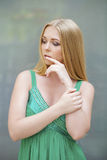 Young beautiful blonde woman thinking about something Stock Images