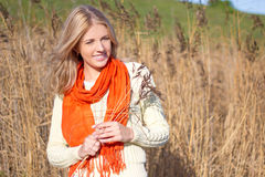 Young beautiful blonde woman walking through sunny yellow autumn Royalty Free Stock Photography