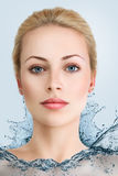 Young woman in water dress Stock Images