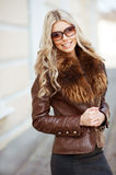 Young beautiful blonde woman wearing sunglasses. Outdoors Royalty Free Stock Image