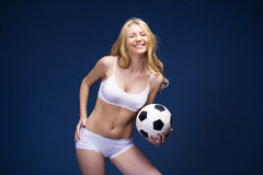 Young beautiful blonde woman in white fitness clothing Stock Image