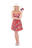 Young beautiful blondie woman in red dress with passport and tic Royalty Free Stock Image