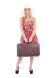 Young beautiful blondie woman in red dress with retro suitcase i Stock Image