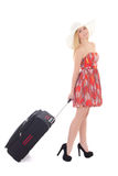 Young beautiful blondie woman in red dress with suitcase isolate Stock Image
