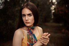 Young beautiful blue-eyed girl in a summer vintage dress in the forest. Portrait of a young beautiful blue-eyed girl in a summer vintage dress in the forest royalty free stock images
