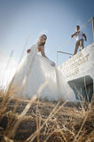 Young beautiful bridal couple flirting outdoors in the sun Stock Image