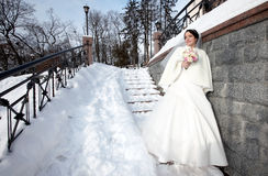 Young beautiful bride. With wedding bouquet royalty free stock photography