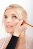 Young beautiful bride  applying wedding make-up Stock Photography