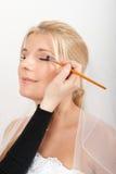 Young beautiful bride applying wedding make-up Stock Photo