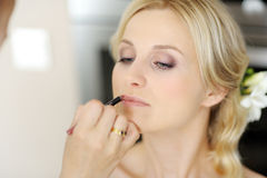 Young Beautiful Bride Applying Wedding Make-up Stock Image
