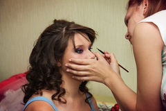 Young beautiful bride applying wedding make-up Royalty Free Stock Photography