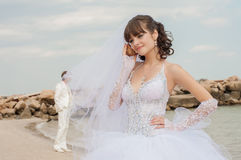 Young beautiful bride on the beach with seashell Royalty Free Stock Photos