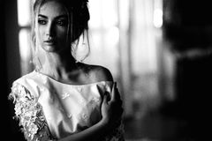 Young beautiful bride in boho style and white feathers Royalty Free Stock Photos