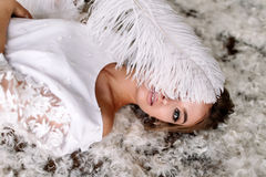 Young beautiful bride in boho style and white feathers.  Royalty Free Stock Image