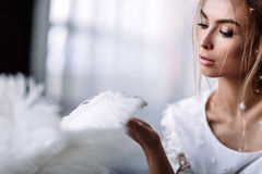 Young beautiful bride in boho style and white feathers.  royalty free stock images