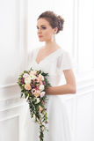 Young and beautiful bride with bouquet Royalty Free Stock Image