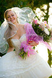 Young beautiful bride with flowers outdoor Royalty Free Stock Photography