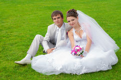 Young and beautiful bride and groom smiling at eac Stock Photography