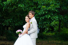 Young and beautiful bride and groom smiling at eac Stock Photo
