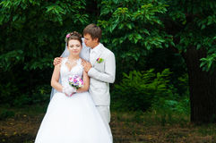 Young and beautiful bride and groom smiling at eac Stock Photos