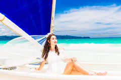 Young beautiful bride having fun on a tropical beach . Tropical Royalty Free Stock Photography