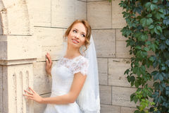 Young beautiful bride on her wedding day. Bride in white dress posing in the photo Royalty Free Stock Image