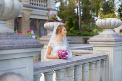 Young beautiful bride on her wedding day. Bride in white dress posing in the photo Stock Image