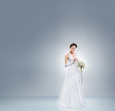 Young and beautiful bride in a long fantasy dress Royalty Free Stock Photos