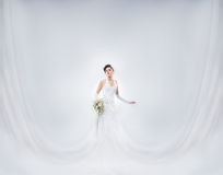 Young and beautiful bride in a long fantasy dress Royalty Free Stock Photo