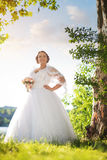 Young beautiful bride in nature Stock Photo