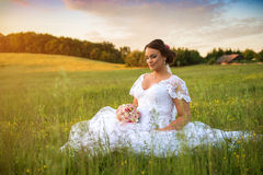 Young beautiful bride in nature. Stock Photos
