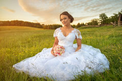 Young beautiful bride in nature. Stock Images