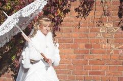 Young beautiful bride near brick wall Stock Photos
