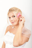 Young beautiful bride with orchid flower Stock Images