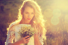 Young Beautiful Bride Outdoors at Sunset Royalty Free Stock Image