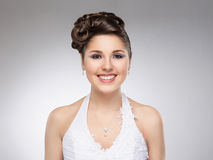 Young and beautiful bride over the grey background Royalty Free Stock Images