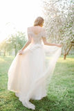 Young beautiful bride portrait in park with flowers Royalty Free Stock Photo