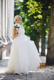 Young beautiful bride posing outdoors. On camera Royalty Free Stock Photo