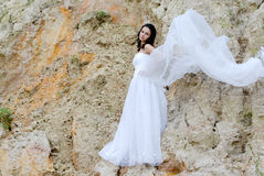 Young beautiful bride among sands thoughtful royalty free stock photos