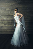 Young beautiful bride sensualy posing in white wedding dress Stock Image