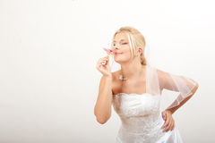 Young beautiful bride smelling orchid flower Stock Image