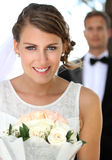 Young beautiful bride smiling and holding a bouquet Royalty Free Stock Image