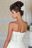 Young beautiful bride standing back to camera Stock Image