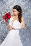 Young and beautiful bride standing with the flower bouquet stock photo