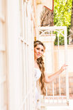 Young beautiful bride waits for groom near the window. Beautiful Bride lit by sunlight. beautiful young bride  waiting Stock Photo