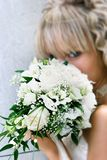 Young beautiful bride with wedding bouquet Royalty Free Stock Photo