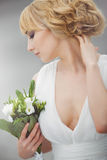 Young beautiful bride with a wedding bouquet. stock photos